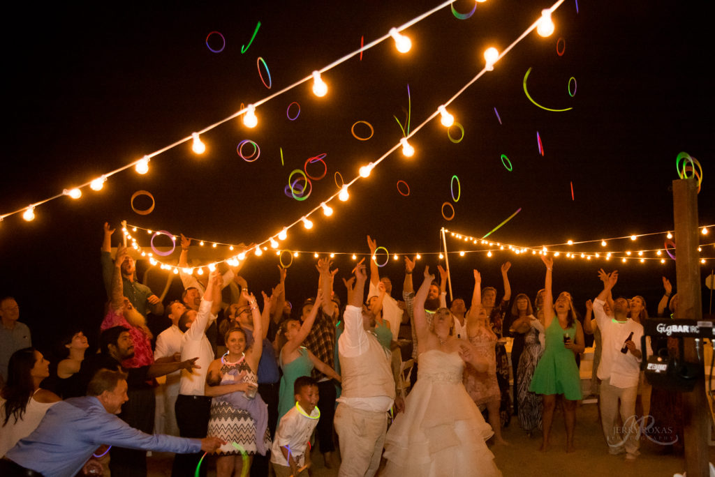beach wedding, glow necklaces at wedding recpetion.