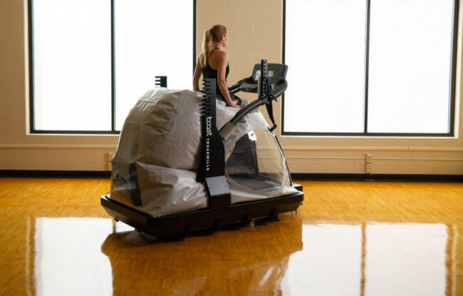 Runner using the Boost Treadmill.