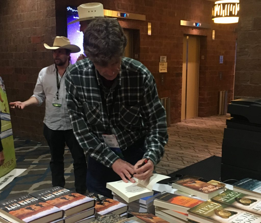 Leo signing books