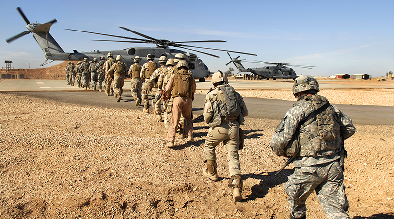 Iraqi Soldiers From The 1st Iraqi Army Division And U.S. Soldiers Board A U.S. Marine Corps CH-53 Super Stallion Helicopter At Camp Ramadi, Iraq, Nov. 15, 2009, During A Static Loading Exercise Being Conducted To Prepare For Upcoming Missions. The Soldiers Are Assigned To The 2nd Battalion, 504th Parachute Infantry Regiment, 1st Brigade Combat Team, 82nd Airborne Division. (DoD Photo By Staff Sgt. Daniel St. Pierre, U.S. Air Force/Released)