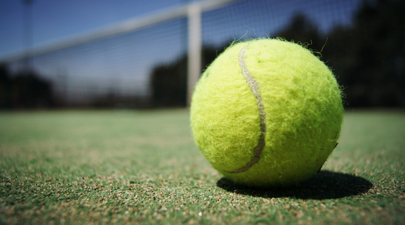 Tennis Ball Laying On The Ground