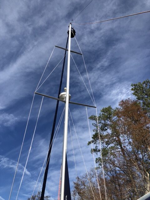 Man a top sailboat mast