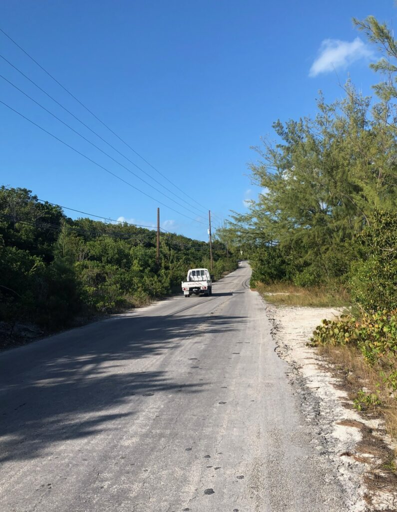 Pickup truck on a Great Harbour Cay road