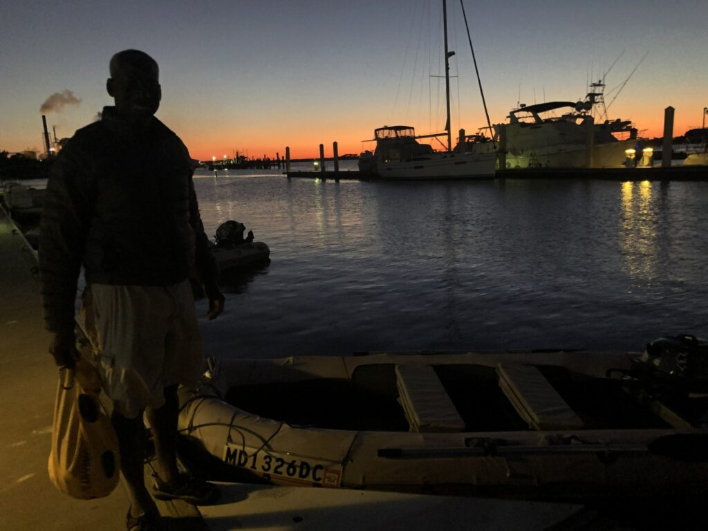 Tying up at the Fernandina dinghy dock as the sun sets