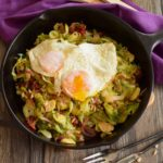 shredded brussels sprouts with eggs over easy
