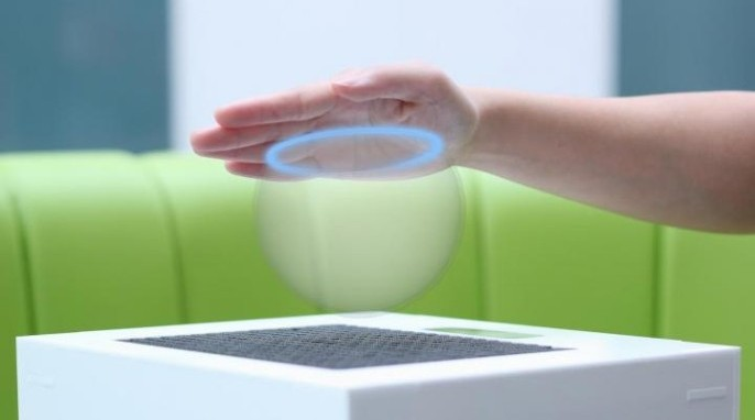 Ultrasound is focused to create a hologram in the shape of a virtual sphere (Bristol Interaction and Graphics group, University of Bristol, © 2014)