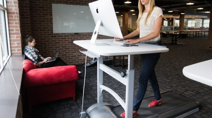 An employee working at a treadmill desk. (Jaren Wilkey/BYU)
