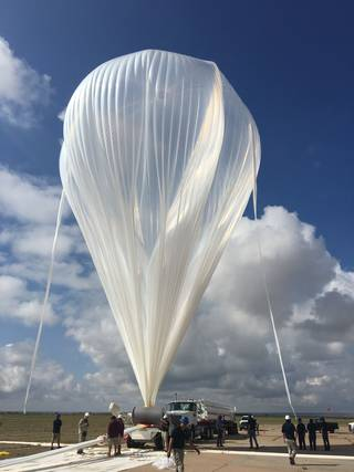 Science Experiments: An 11.8-million-cubic-foot scientific balloon is fully inflated in preparation to launch the High-Altitude Student Platform Payload. Credits: NASA/Alan Haggard