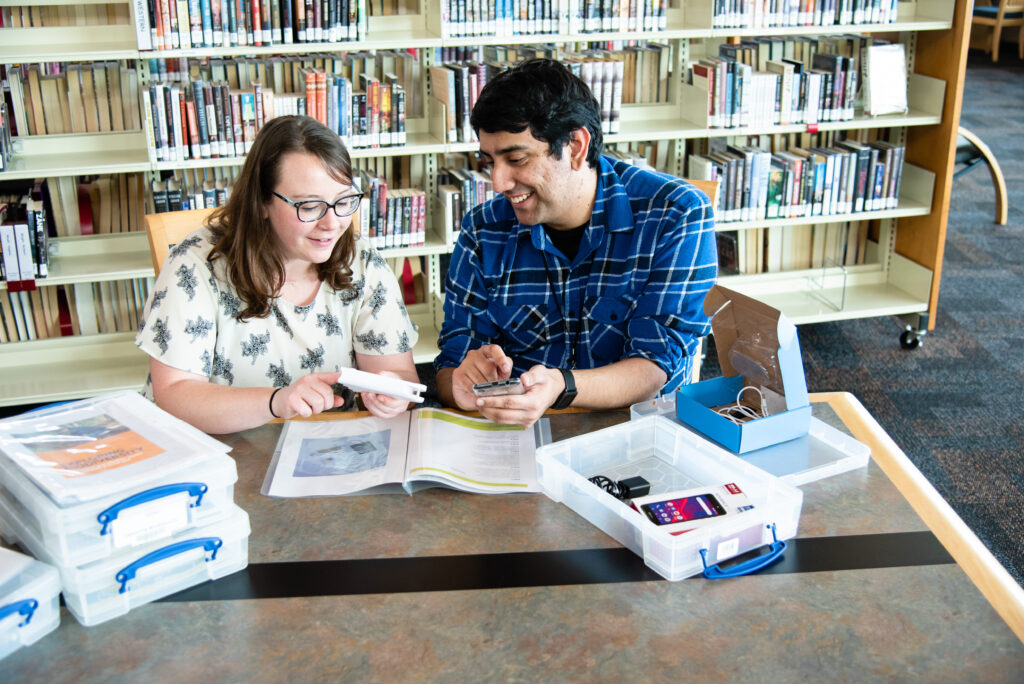 Cultural heritage and citizen science: Southeast Regional Library staff reading instructions for one of the library kits. Credit: Emily Maltez/CC BY-NC-SA 4.0