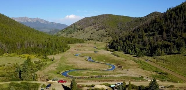 the Swan River restoration project in Summit County CO (http://www.co.summit.co.us/Blog.aspx?CID=5), which is working to reestablish a natural, healthy, and vibrant ecological system in the mountains, which used to be an old mining area.