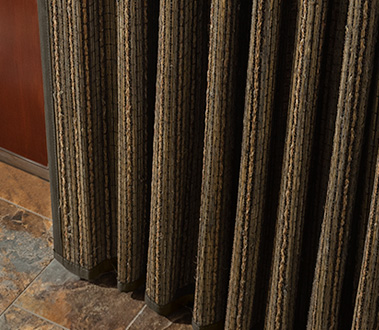 Add breathtaking natural beauty to wide windows, patio doors, or closets. Organic shade materials hang vertically to change the look of your room. Optional liners add more privacy and light control.