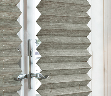 Graber EvenPleat® and FashionPleat® Shades add depth and structure to traditional shades through evenly spaced, crisp folds of fabric.