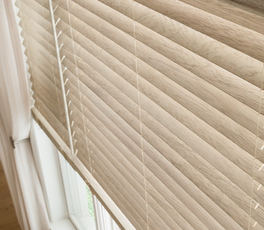 From rustic to ultramodern, Graber Traditions® Wood Blinds can take on a variety of paint and stain colors, setting the tone for your living spaces and carrying an aesthetic theme from room to room.