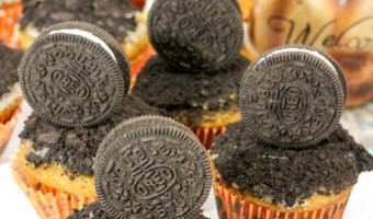 """Celebrate the return of """"pumpkin spice season"""" with our delicious pumpkin Halloween muffins with crushed Oreo cookies topping & vanilla glaze frosting!"""