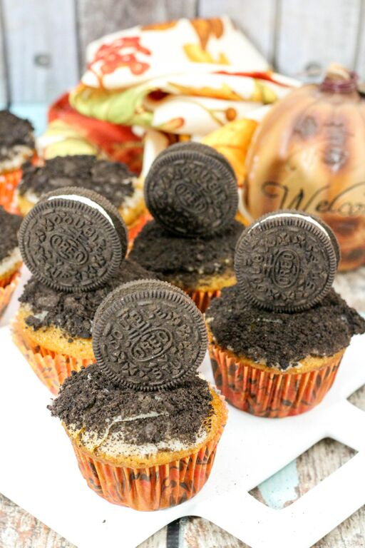 "Celebrate the return of ""pumpkin spice season"" with our delicious pumpkin Halloween muffins with crushed Oreo cookies topping & vanilla glaze frosting!"