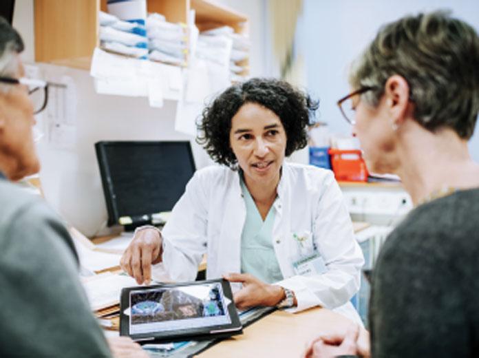 Nurse talking to patients