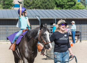 Flash's rider waves to family as she completes her barrel race