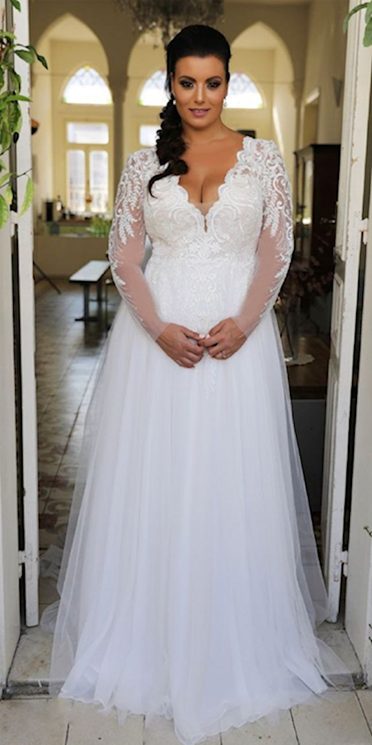 Plus Size Wedding Dresses Cheap.Plus Size A Line Wedding Dress On Woman In Doorway