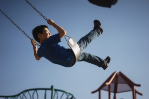 boy on swing with blue skies day is drug addict needs drug intervention