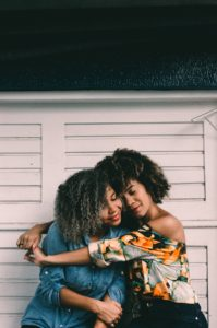 black trendy mom hugging daughter help from interventionist don' wait