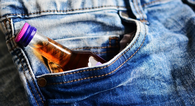small bottle of alcohol l in side pocket of jeans needs addiction quiz
