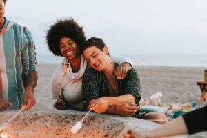 woman roasting marshmellow with man, no more enabling, interventions help
