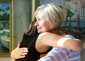 mom hugging daughter at eating disorder intervention