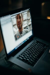 virtual recovery support man seen on screen of laptop help for drug intervention