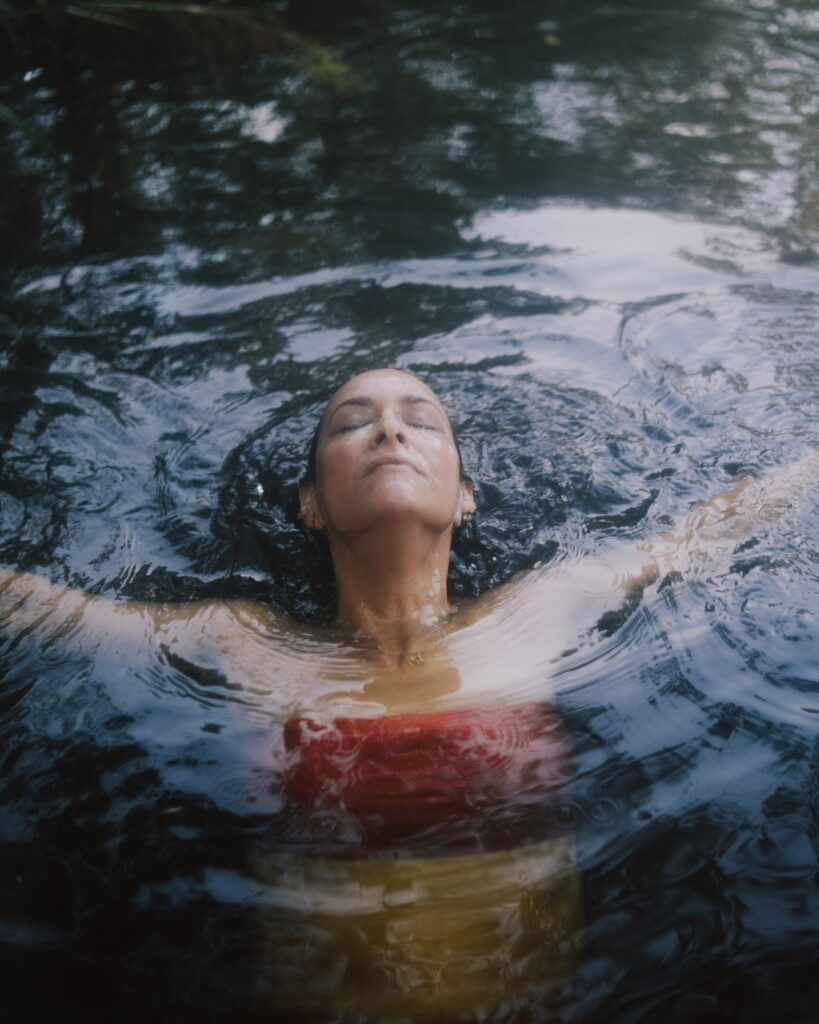 women floating in water floating on back recovery coaching