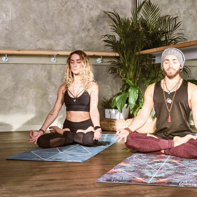 man and woman doing yoga, tools for addiction and recovery