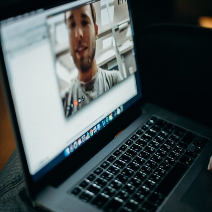 virtual recovery support man seen on screen of laptop