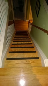 new hardwood and tread riser grips on stairs
