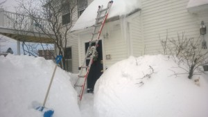 shoveling the front entranceway roof during snowmageddon 2015
