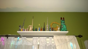 ikea ekby hemnes shelf with long tailed cats in living room