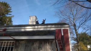 me and briggs sitting on the barn roof