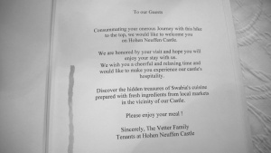 the welcome page of the menu at castle hohen neuffen, germany