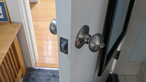 i replaced the brass doorknobs in our house with silver