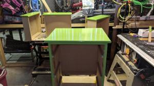 i put 4 coats of high gloss bm rosemary green on jim's cupboard