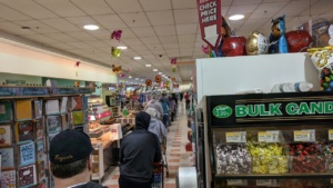 the new normal - waiting in line to checkout market basket rowley