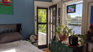 view of the screen door from inside the bedroom