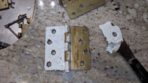 after boiling the painted brass hinges, i scraped the paint off
