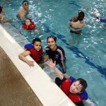 kids swimming in Gold Fish Swim School Pool with Holly of Peak Potential Therapy