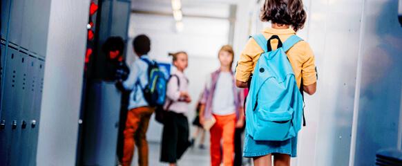 Girl Walking Down School Hallway