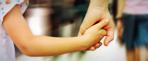 Mother Holding Child's Hand