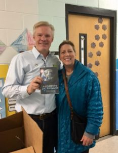 Vericom CEO Blake Philips delivering dictionaries with Laura Brockman.