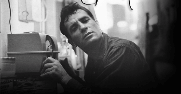 Beat poet Jack Kerouac relishing a little jazz with eyes closed and ear turned to the speaker on his radio.