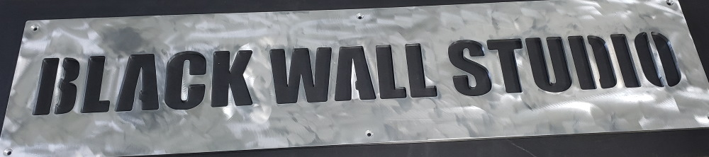 Aluminum sign for Black Wall Media