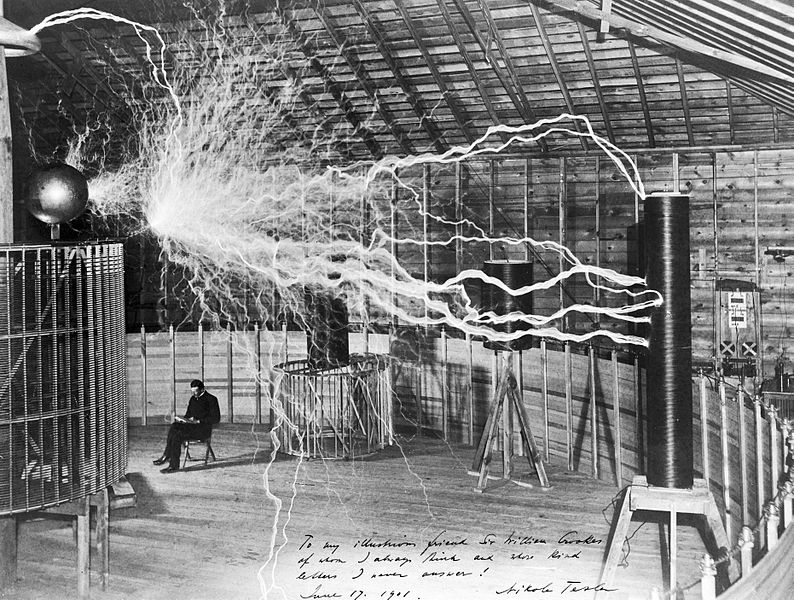 Nikola Tesla with equipment