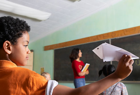 getty_rf_photo_of_boy_throwing_airplane_in_class
