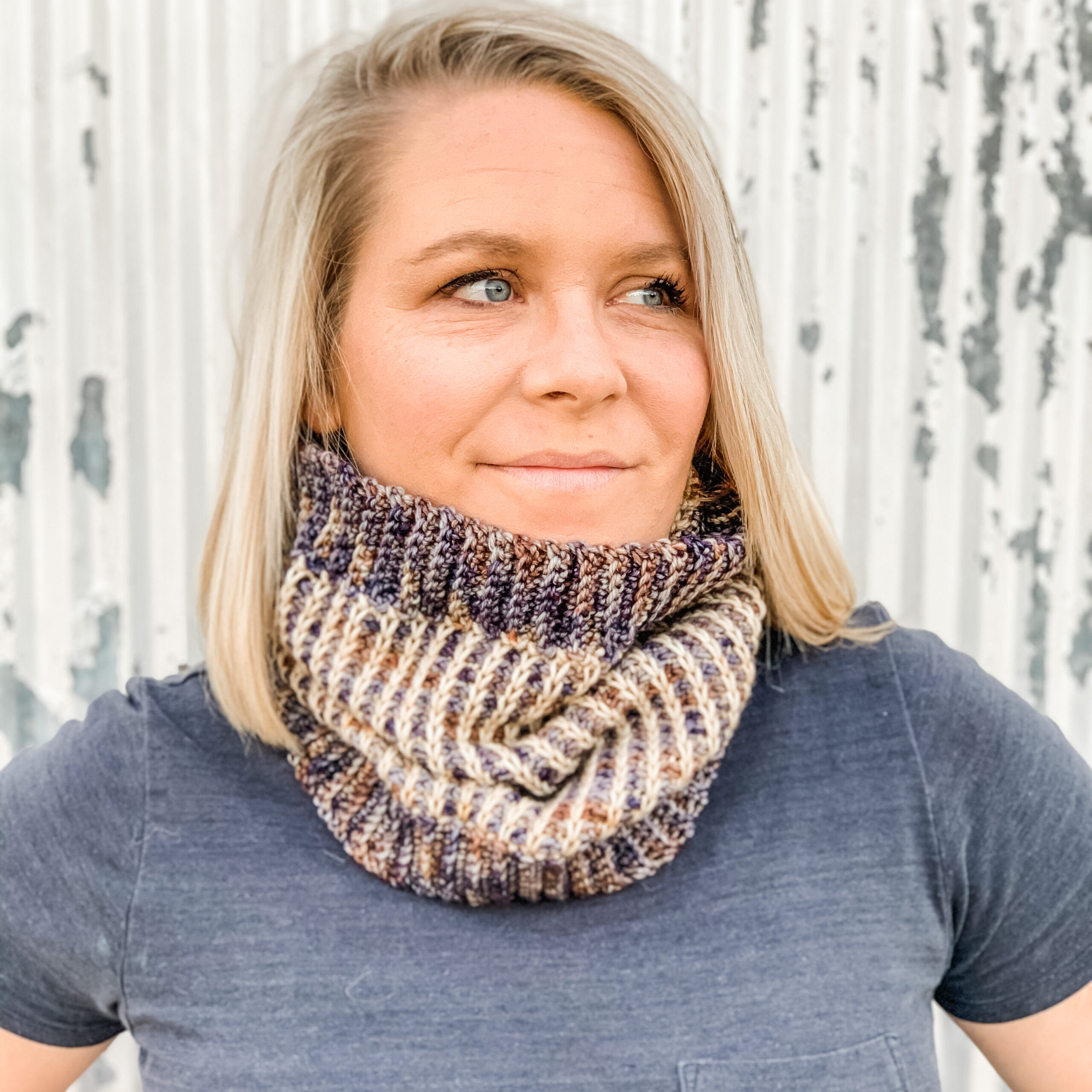 Woman wearing two color tunisian ribbed cowl